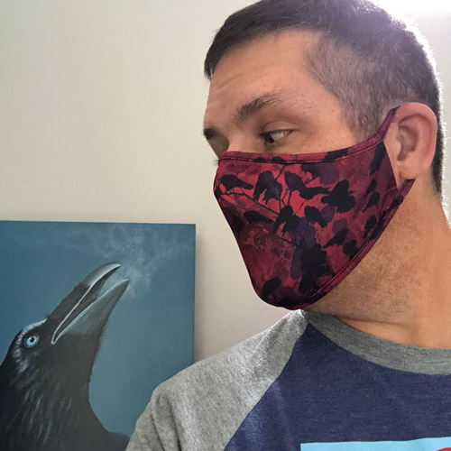 profile picture of artist Rob Shaw, wearing one of his wearable art masks